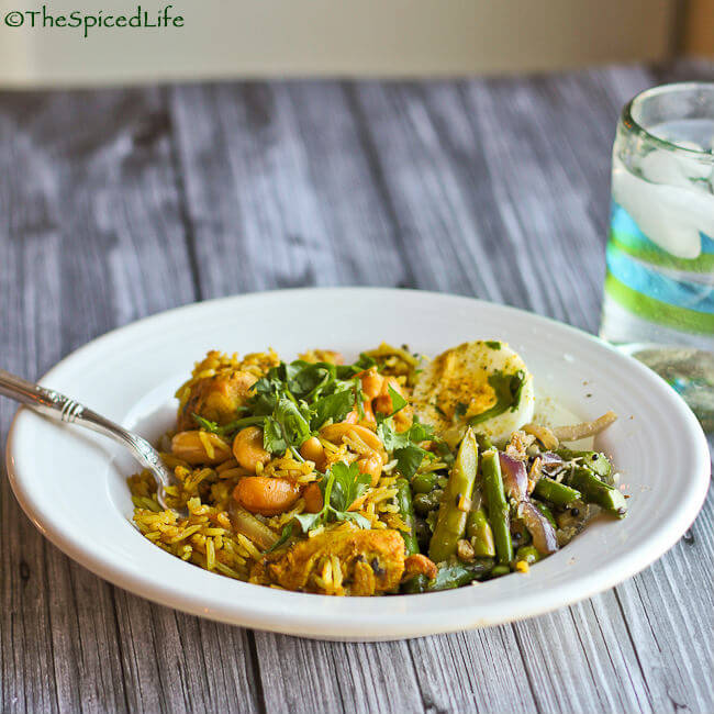 Fabulously easy and delicious Indian #GlutenFree meal! Slow cooked chicken is used to make an outstanding pilaf served with a stir fried Asparagus with Ginger