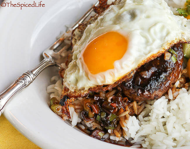 Loco Moco, a Hawaiian specialty with rice, hamburger, gravy, and a fried egg--served with a Mango Cucumber Relish