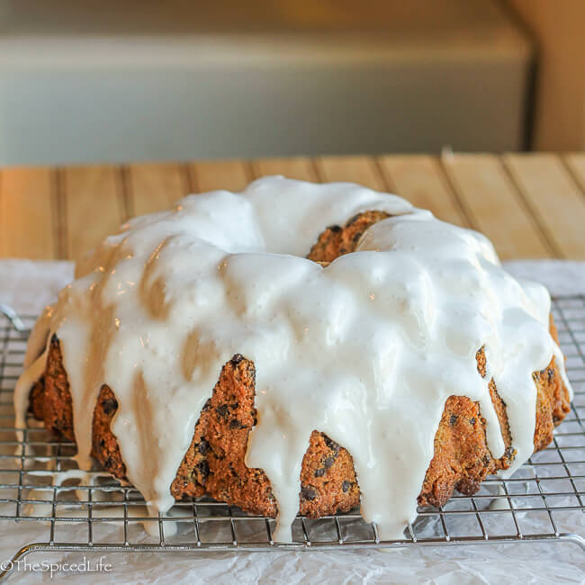 S'mores Graham Cracker Bundt Cake: a graham cracker cake filled with chocolate chip and swathed in toasted marshmallow fluff does a pretty darn good job of emulating your favorite summer treat!
