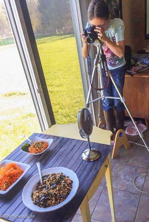 My daughter photographing Spiralized Sake Carrot Salad with Nori Granola