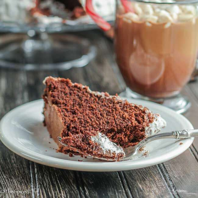 Peppermint Hot Chocolate Cake: All the flavors of Peppermint Hot Chocolate in a bunt cake--topped with peppermint marshmallow! Perfect dessert for the holidays--and if you ask my family, the perfect dessert all winter long!