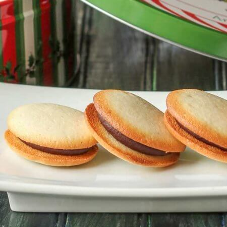 Biarritz Sandwich Cookies: crisp French butter cookies sandwiched around dark chocolate ganache