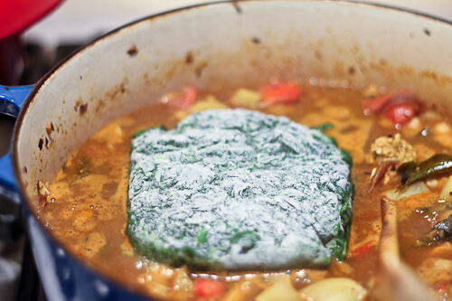 Frozen spinach melting into an Indian curry