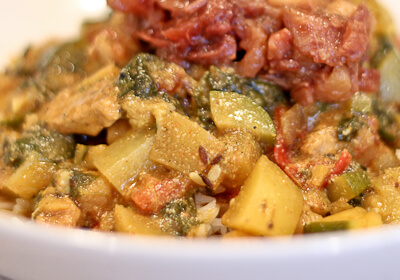 Indian curry with zucchini, potatoes, chickpeas, chicken and spinach