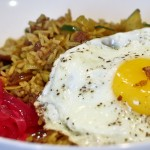 Persian Rice and Beans with pickled red onions and fried eggs, sunny side up