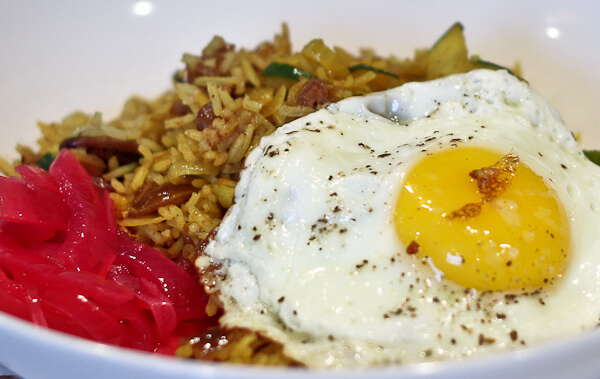 Persian Rice and Beans with pickled red onions and fried eggs