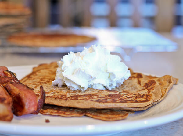 Gingerbread Pancakes topped with whipped cream