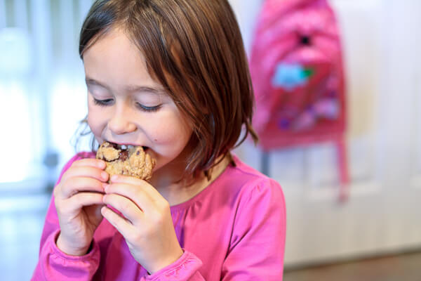 child eating browned butter dark chocolate chunk cookie