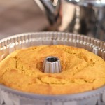 Orange Pumpkin Bundt Cake cooling in fleur de lis pan