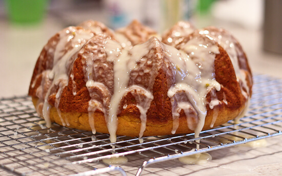 Glaze dripping off of Glazed Orange Pumpkin Bundt Cake