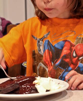child eating triple chocolate pancakes