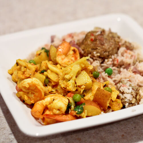 Bengali curry with shrimp, cauliflower and peas