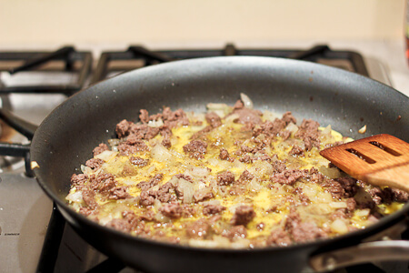 Scrambling eggs with ground beef