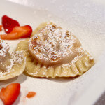 Pierogi stuffed with strawberries macerated in vodka