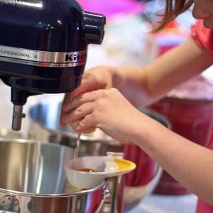 Child Using OXO 3 in 1 egg separator