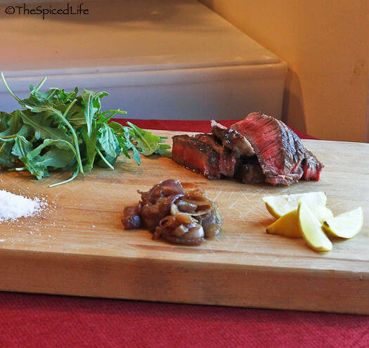 Steak Salad with Arugula, Caramelized Onions, Lemon and Salt