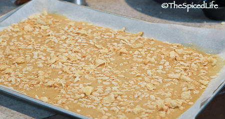 Oven Brittle Topped with potato Chips and Rice Krispies before baking