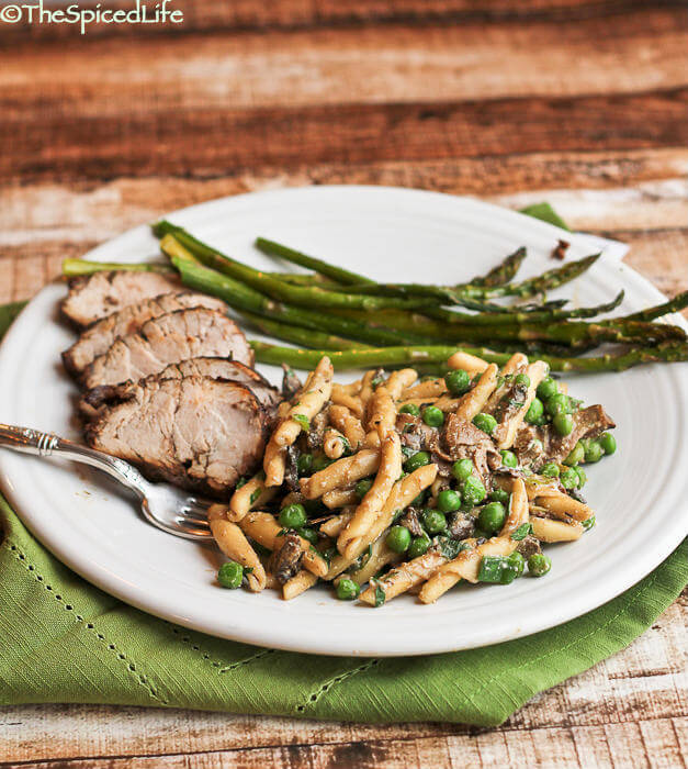 Roasted Mustard Balsamic Pork Tenderloin served with Pasta and Peas with Mushrooms