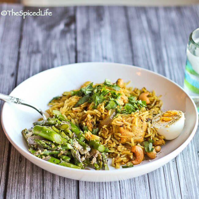 Fabulously easy and delicious Indian #GlutenFree meal! Slow cooked chicken is used to make an outstanding Indian pilaf served with a stir fried Indian Asparagus with Ginger