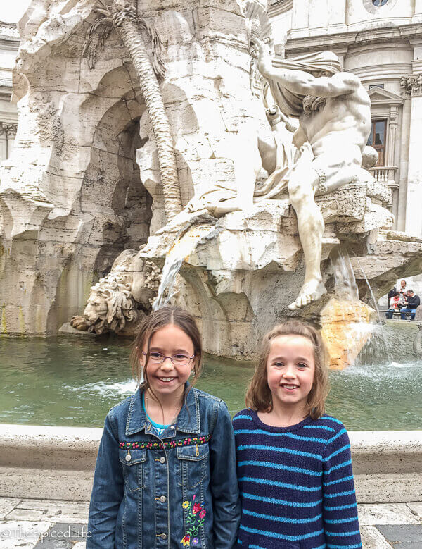 kids in front of Nile river god in fountain of the four rivers, Piazza Navona, Rome