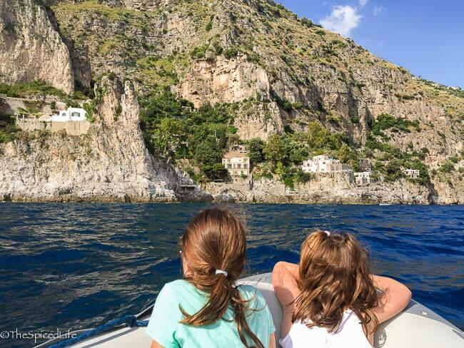 kids in boat looking at Amalfi coast