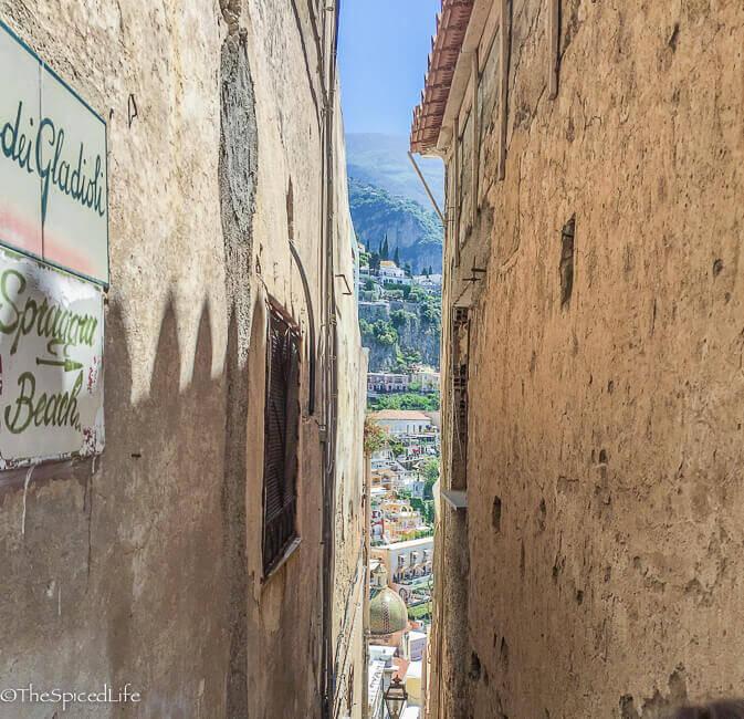 view between buildings in Positano