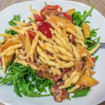 Pasta with Peaches, Prosciutto and Arugula: a delicious and healthy meal I whipped up one evening while we were living in Italy!