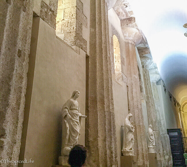 "The ""bones"" of the Duomo--the columns are from an ancient temple to Athena. The Duomo di Siracusa was the most interesting cathedral we saw in Italy and my favorite part of traveling in Sicily!"