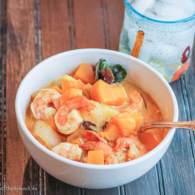 Shrimp, Pineapple and butternut Squash Curry is perfect for a weeknight! Comes together fast, so you can get dinner on the table quickly, and is absolutely delicious!