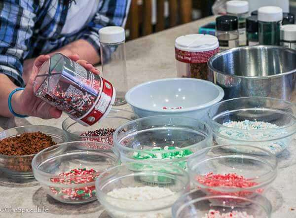 Laying out holiday sprinkles for Holiday Biscotti Bar