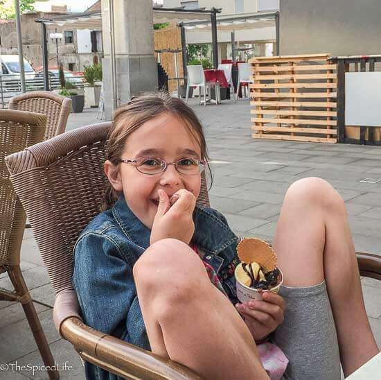 Child enjoying gelato in Rende, Calabria, Italy