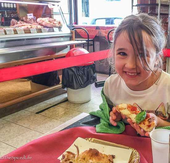 Child enjoying pizza in Testaccio, Rome, Italy