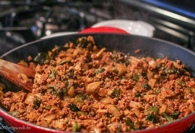 Chorizo cooked with onions and roasted poblanos for queso fundido
