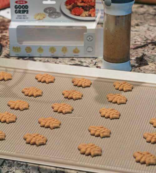 Spritz Cookies with Browned Butter, Chinese 5 Spice and Apple Brandy on OXO cookie sheet