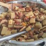 pasta mixed into sauce