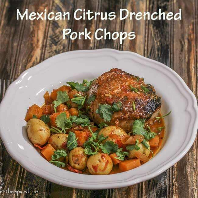 Mexican Citrus Drenched Pork Chops over Butternut Squash and Potatoes